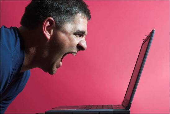 man screaming at laptop